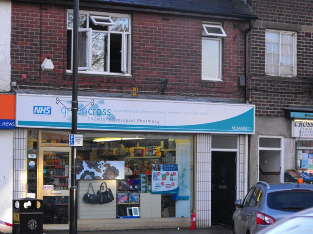 Flat above chemist with open windows