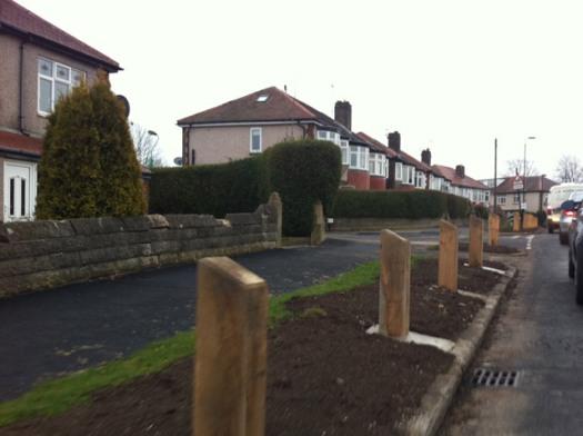 Wooden bollards installed on Stephen Hill