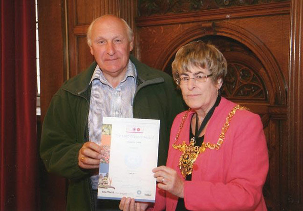 The silver prize is presented to Crosspool Forum chairman Ian Hague by Lord Mayor Sylvia Dunkley at the Town Hall