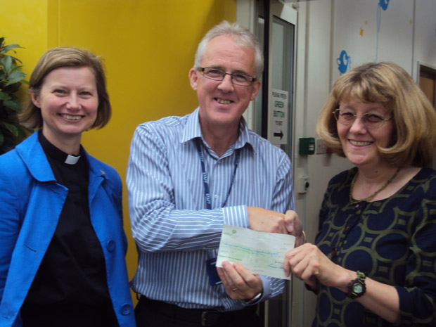 Frances Eccleston, the Priest in Charge at St. Columba's and Eileen Kehoe present the cheque to Dave Threlfall, Head of Therapies at Ryegate