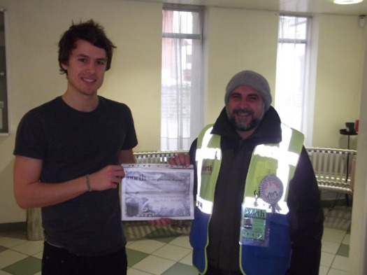 Crosspool Big Issue in the North seller Mohammad Iqbal picks up his award