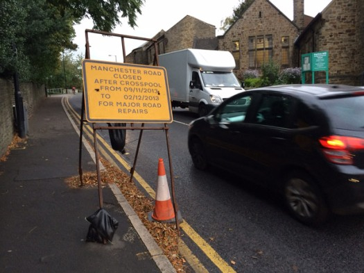 Sign warning motorists of A57 Manchester Road repairs