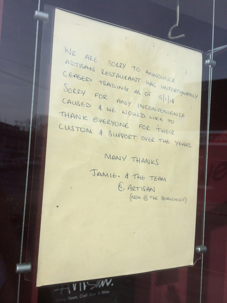 The sign on the window of Artisan
