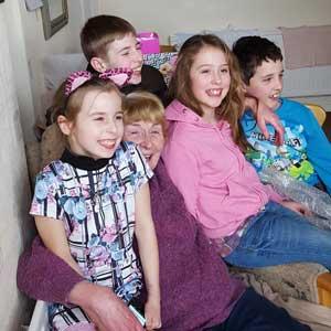 Children's author Ann Twigg with her grandchildren