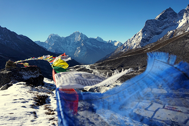 3. Prayer flags fluttering in the wind over the Gokyo Valley in the Himalayas