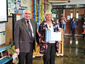 Glenda Debrouwer receives Crosspool Forum Community award from chair Ian Hague